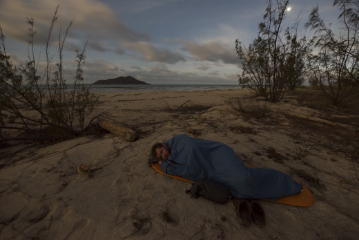 Keeping a low footprint while traveling alone is much easier.  Here, I am sleeping just above the beach on Getullai Island in the Torres Strait, Australia before photographing a tern colony the next morning.